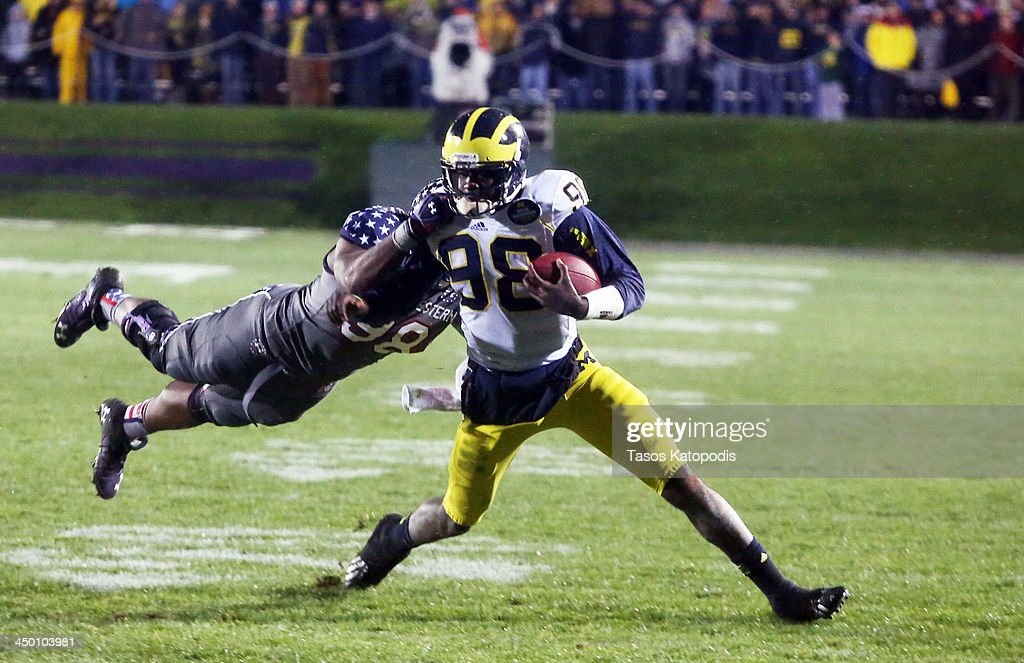<a gi-track='captionPersonalityLinkClicked' href=/galleries/search?phrase=Devin+Gardner&family=editorial&specificpeople=6427914 ng-click='$event.stopPropagation()'>Devin Gardner</a> #98 of the Michigan Wolverines outruns Deonte Gibson #98 of the Northwestern Wildcats during play in overtime at Ryan Field on November 16, 2013 in Evanston, Illinois.