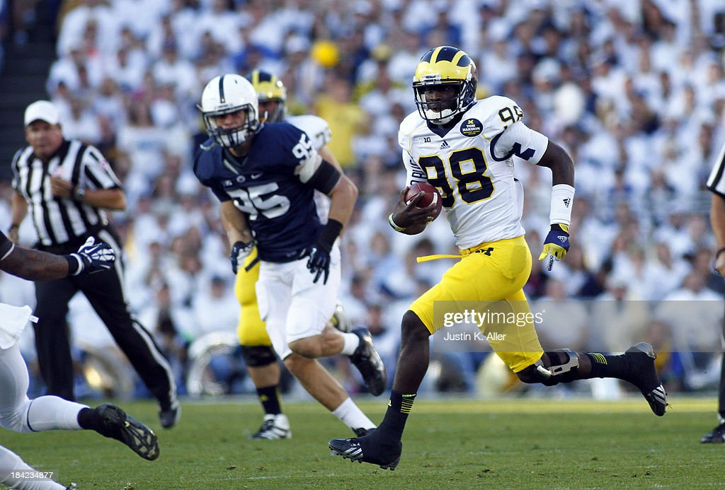 <a gi-track='captionPersonalityLinkClicked' href=/galleries/search?phrase=Devin+Gardner&family=editorial&specificpeople=6427914 ng-click='$event.stopPropagation()'>Devin Gardner</a> #98 of the Michigan Wolverines rushes against the Penn State Nittany Lions during the game on October 12, 2013 at Beaver Stadium in State College, Pennsylvania.