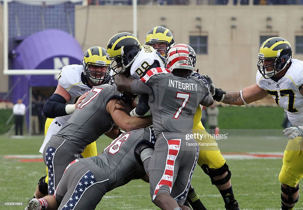 <a gi-track='captionPersonalityLinkClicked' href=/galleries/search?phrase=Devin+Gardner&family=editorial&specificpeople=6427914 ng-click='$event.stopPropagation()'>Devin Gardner</a> #98 runs of Michigan Wolverines runs the ball against the Northwestern Wildcats at Ryan Field on November 16, 2013 in Evanston, Illinois.