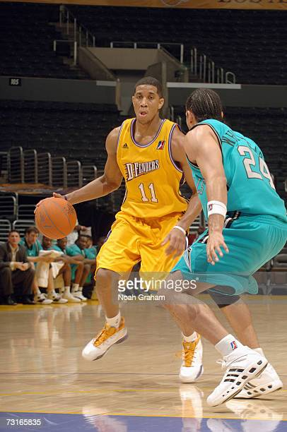 Devin Green of the Los Angeles DFenders controls the ball against Luke Whitehead of the Sioux Falls Skyforce on December 6 2006 at Staples Center in...