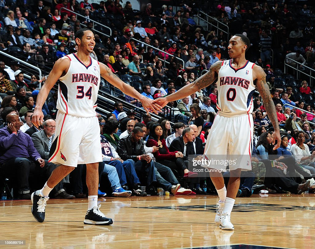 Devin Harris #34 and Jeff Teague #0 of the Atlanta Hawks congratulate each other during the game against the Brooklyn Nets on January 16, 2013 at Philips Arena in Atlanta, Georgia.