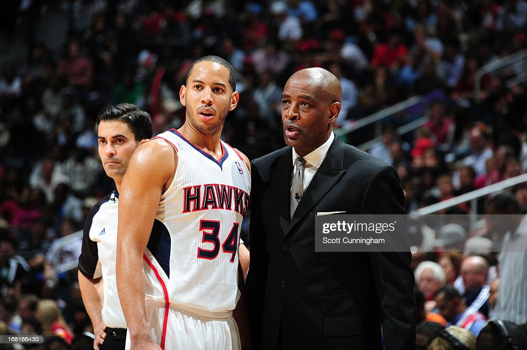 Devin Harris #34 and Larry Drew of the Atlanta Hawks talk during the game against the Indiana Pacers during Game Six of the Eastern Conference Quarterfinals in the 2013 NBA Playoffs on May 3, 2013 at Philips Arena in Atlanta, Georgia.