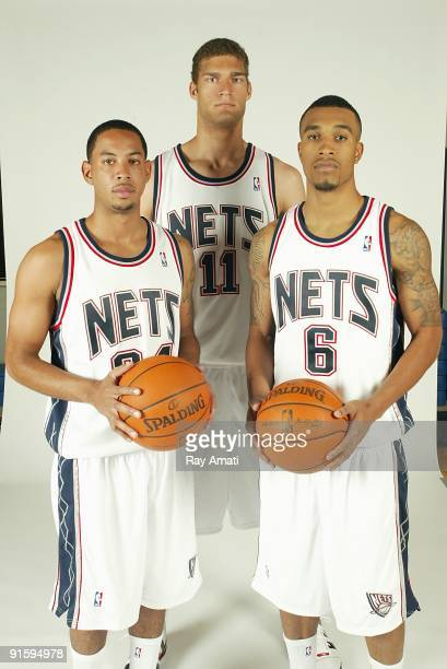 Devin Harris Brook Lopez and Courtney Lee of the New Jersey Nets pose for a portrait during 2009 NBA Media Day on September 28 2009 at the Nets...