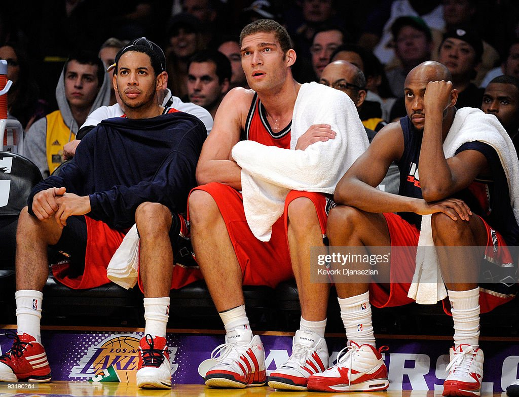 Devin Harris (L) Brook Lopez (C) and Trenton Hassell of the New Jersey Nets reacts after a missed shot by a teammate in the closing minutes of the basketball game against the Los Angeles Lakers at Staples Center on November 29, 2009 in Los Angeles, California. The Nets tied for the worst start to an NBA season with their 17th straight loss.