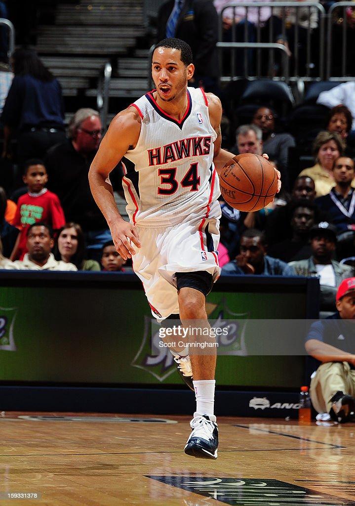 Devin Harris #34 of the Atlanta Hawks brings the ball up the floor against the Utah Jazz on January 11, 2013 at Philips Arena in Atlanta, Georgia.