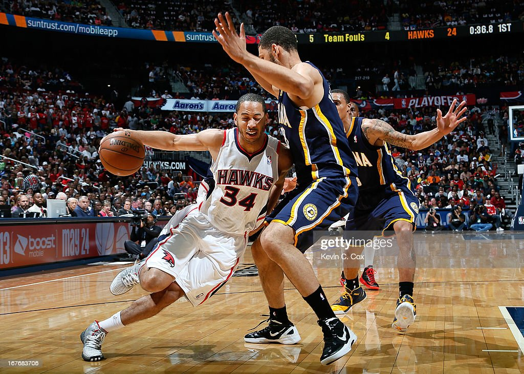 Devin Harris #34 of the Atlanta Hawks drives against Jeff Pendergraph #29 of the Indiana Pacers during Game Three of the Eastern Conference Quarterfinals of the 2013 NBA Playoffs at Philips Arena on April 27, 2013 in Atlanta, Georgia.
