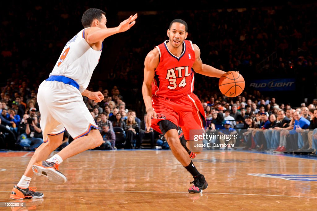Devin Harris #34 of the Atlanta Hawks drives against Pablo Prigioni #9 of the New York Knicks at Madison Square Garden on January 27, 2013 in New York, New York.