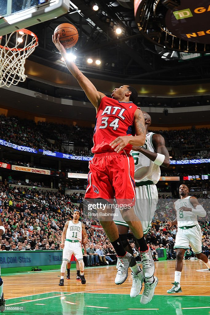 <a gi-track='captionPersonalityLinkClicked' href=/galleries/search?phrase=Devin+Harris&family=editorial&specificpeople=202195 ng-click='$event.stopPropagation()'>Devin Harris</a> #34 of the Atlanta Hawks drives to the basket against the Boston Celtics on March 8, 2013 at the TD Garden in Boston, Massachusetts.