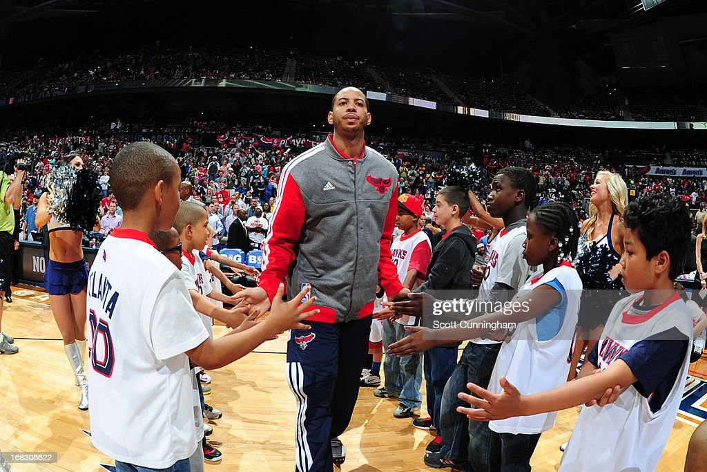 Devin Harris #34 of the Atlanta Hawks gets introduced prior to the game against the Indiana Pacers in Game Three of the Eastern Conference Quarterfinals in the 2013 NBA Playoffs on April 27, 2013 at Philips Arena in Atlanta, Georgia.
