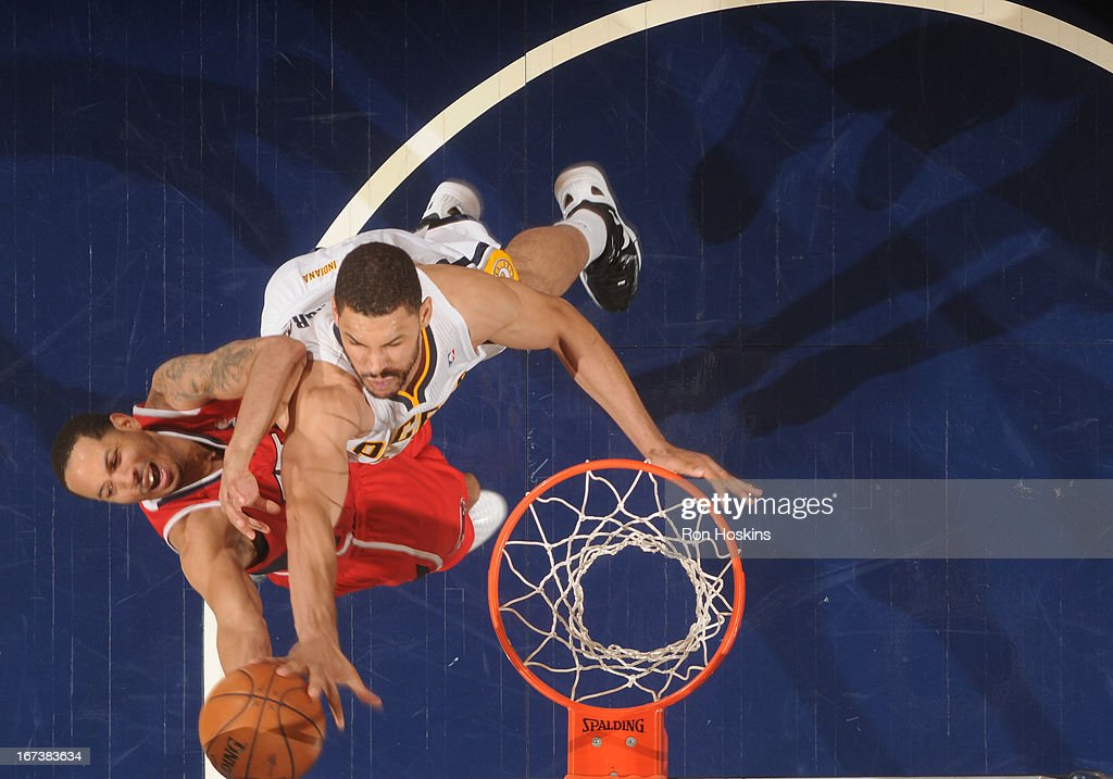 <a gi-track='captionPersonalityLinkClicked' href=/galleries/search?phrase=Devin+Harris&family=editorial&specificpeople=202195 ng-click='$event.stopPropagation()'>Devin Harris</a> #34 of the Atlanta Hawks goes to the basket during the Game Two of the Eastern Conference Quarterfinals between the Indiana Pacers and the Atlanta Hawks on April 24, 2013 at Bankers Life Fieldhouse in Indianapolis, Indiana.