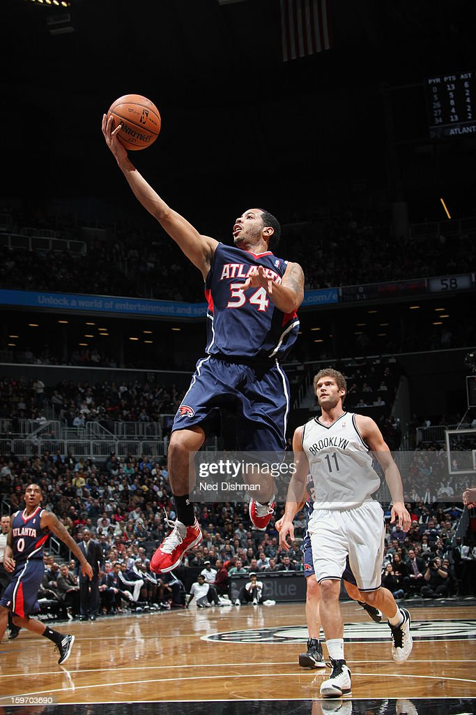 Devin Harris #34 of the Atlanta Hawks goes up for the layup against the Brooklyn Nets at the Barclays Center on January 18, 2013 in the Brooklyn borough of New York City in New York City.