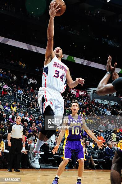 Devin Harris of the Atlanta Hawks goes up for the layup against the Los Angeles Lakers on March 13 2013 at Philips Arena in Atlanta Georgia NOTE TO...