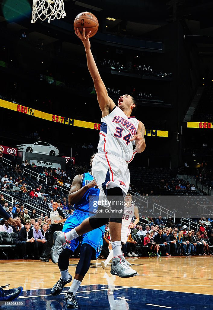 Devin Harris #34 of the Atlanta Hawks goes up for the layup against the Dallas Mavericks on March 18, 2013 at Philips Arena in Atlanta, Georgia.