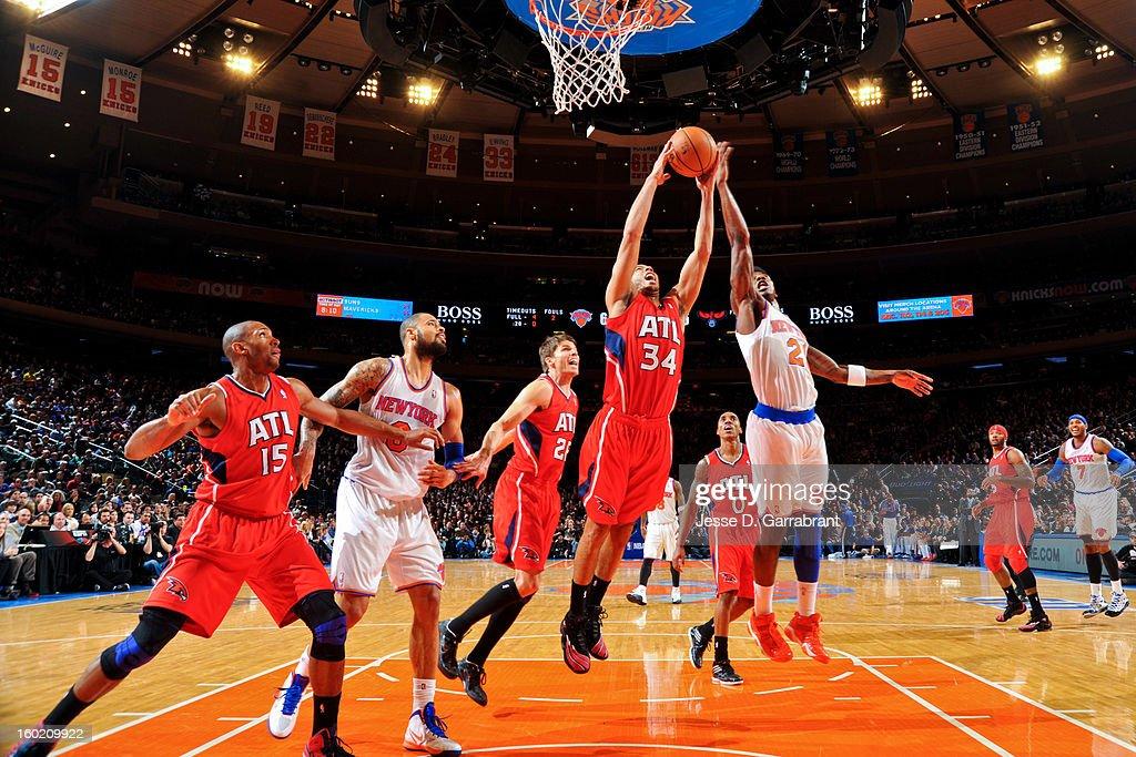 Devin Harris #34 of the Atlanta Hawks grabs a rebound against Iman Shumpert #21 of the New York Knicks at Madison Square Garden on January 27, 2013 in New York, New York.