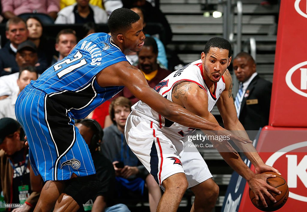Devin Harris #34 of the Atlanta Hawks grabs a rebound against Maurice Harkless #21 of the Orlando Magic at Philips Arena on March 30, 2013 in Atlanta, Georgia.