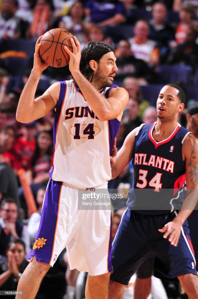 Devin Harris #34 of the Atlanta Hawks guards Luis Scola #14 of the Phoenix Suns on March 1, 2013 at U.S. Airways Center in Phoenix, Arizona.