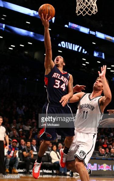 Devin Harris of the Atlanta Hawks in action against Brook Lopez of the Brooklyn Nets at Barclays Center on January 18 2013 in the Brooklyn borough of...