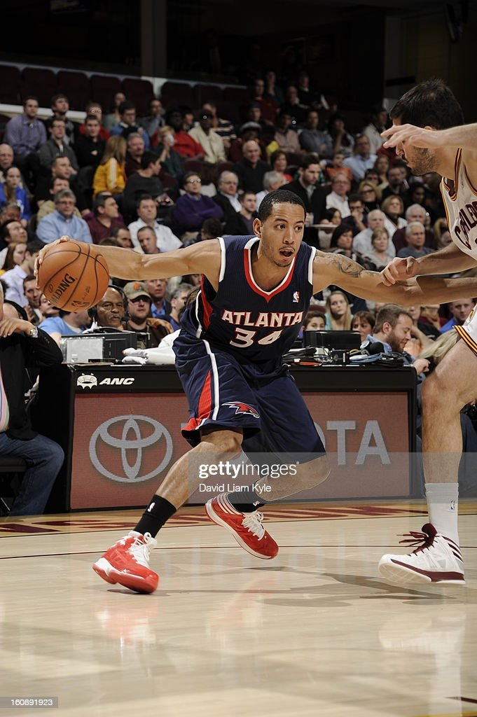 <a gi-track='captionPersonalityLinkClicked' href=/galleries/search?phrase=Devin+Harris&family=editorial&specificpeople=202195 ng-click='$event.stopPropagation()'>Devin Harris</a> #34 of the Atlanta Hawks looks to drive to the basket against the Cleveland Cavaliers at The Quicken Loans Arena on January 9, 2013 in Cleveland, Ohio.