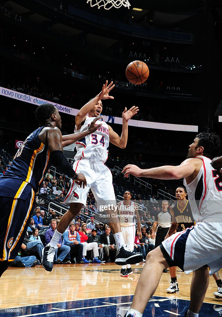 <a gi-track='captionPersonalityLinkClicked' href=/galleries/search?phrase=Devin+Harris&family=editorial&specificpeople=202195 ng-click='$event.stopPropagation()'>Devin Harris</a> #34 of the Atlanta Hawks makes a pass against the Indiana Pacers at Philips Arena on November 7, 2012 in Atlanta, Georgia.