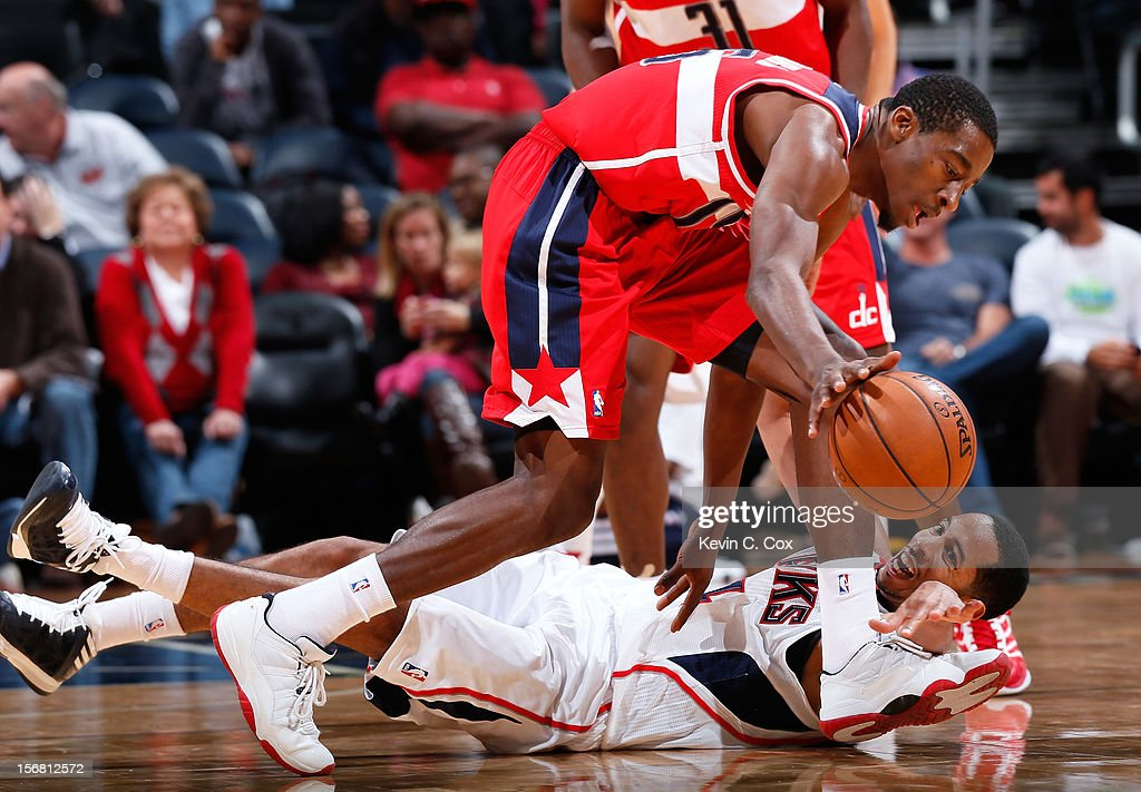 <a gi-track='captionPersonalityLinkClicked' href=/galleries/search?phrase=Devin+Harris&family=editorial&specificpeople=202195 ng-click='$event.stopPropagation()'>Devin Harris</a> #34 of the Atlanta Hawks reaches for a steal against <a gi-track='captionPersonalityLinkClicked' href=/galleries/search?phrase=Jordan+Crawford&family=editorial&specificpeople=4779380 ng-click='$event.stopPropagation()'>Jordan Crawford</a> #15 of the Washington Wizards at Philips Arena on November 21, 2012 in Atlanta, Georgia.