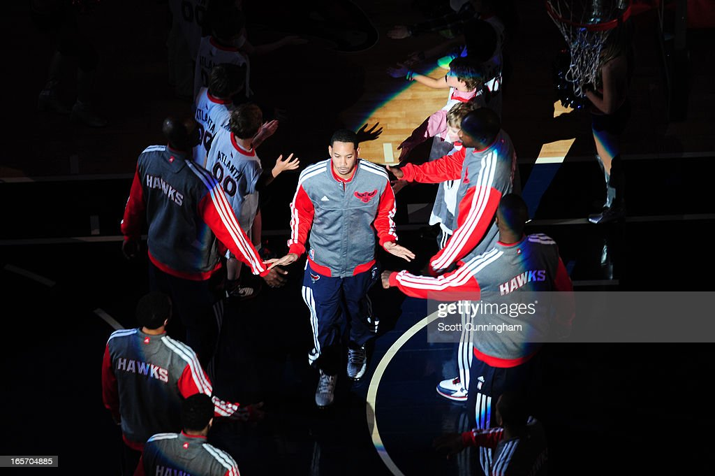<a gi-track='captionPersonalityLinkClicked' href=/galleries/search?phrase=Devin+Harris&family=editorial&specificpeople=202195 ng-click='$event.stopPropagation()'>Devin Harris</a> #34 of the Atlanta Hawks runs out before the game against the Milwaukee Bucks on March 20, 2013 at Philips Arena in Atlanta, Georgia.