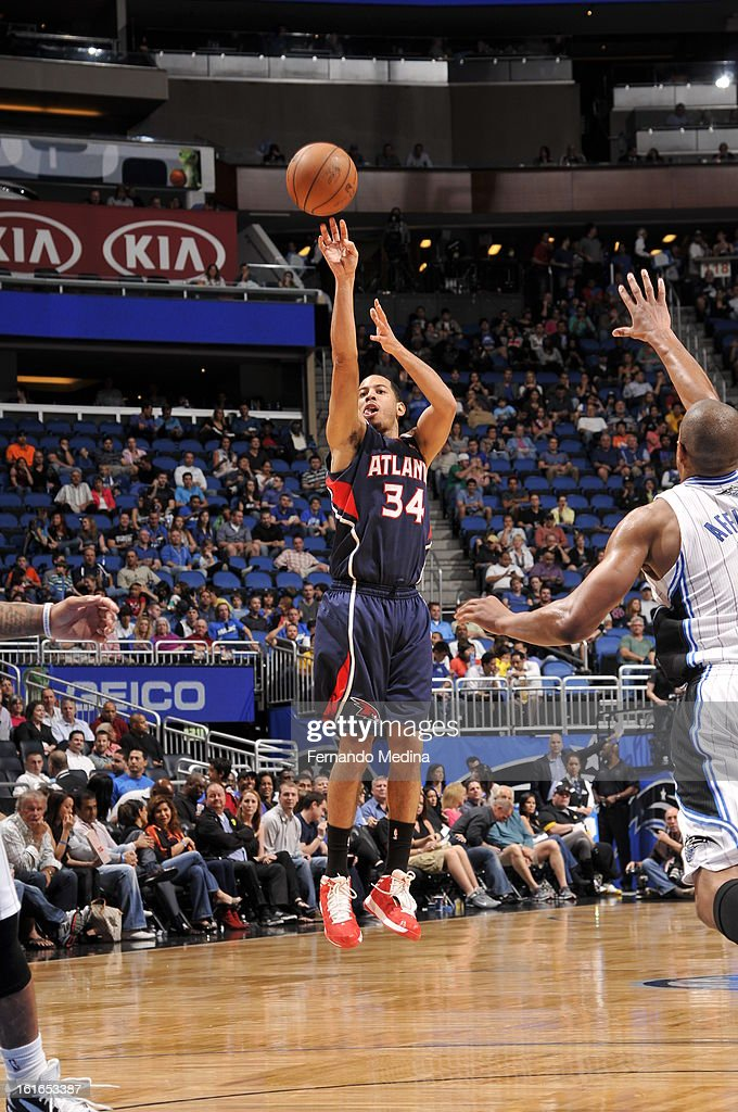 Devin Harris #34 of the Atlanta Hawks shoots a three pointer against the Orlando Magic during the game on February 13, 2013 at Amway Center in Orlando, Florida.