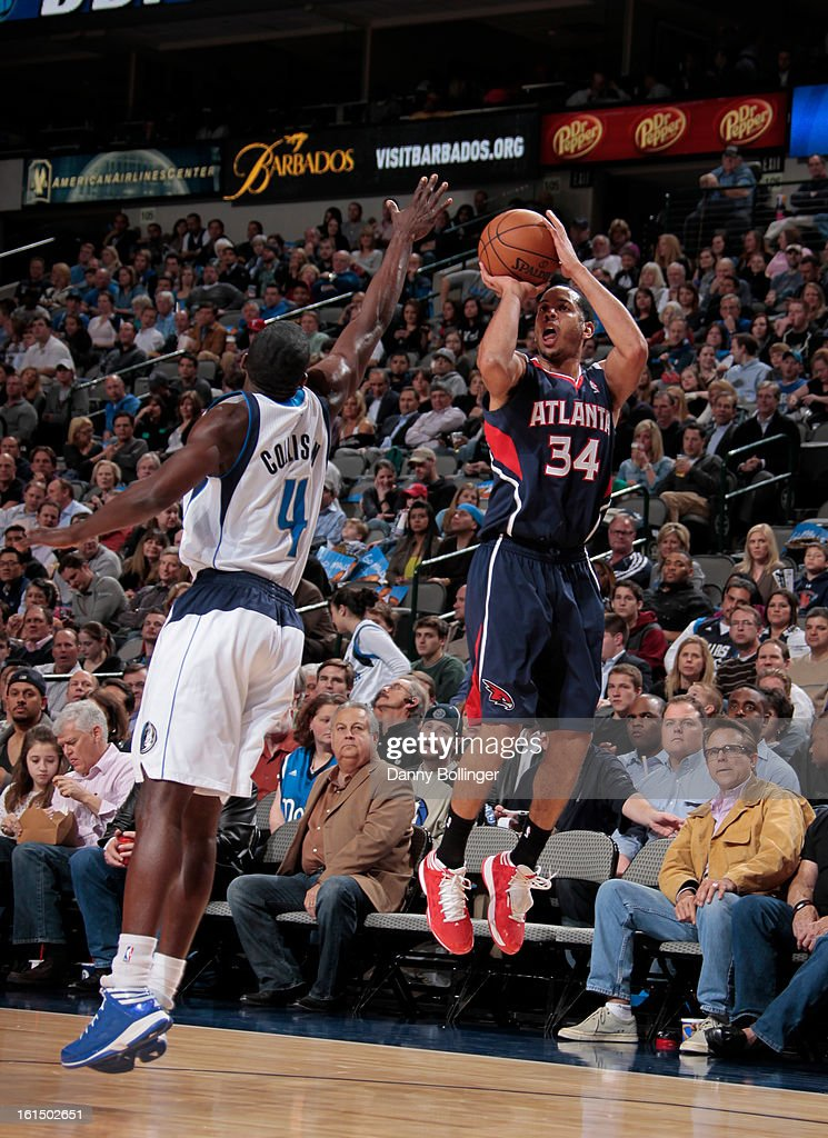 Devin Harris #34 of the Atlanta Hawks shoots against Darren Collison #4 of the Dallas Mavericks on February 11, 2013 at the American Airlines Center in Dallas, Texas.