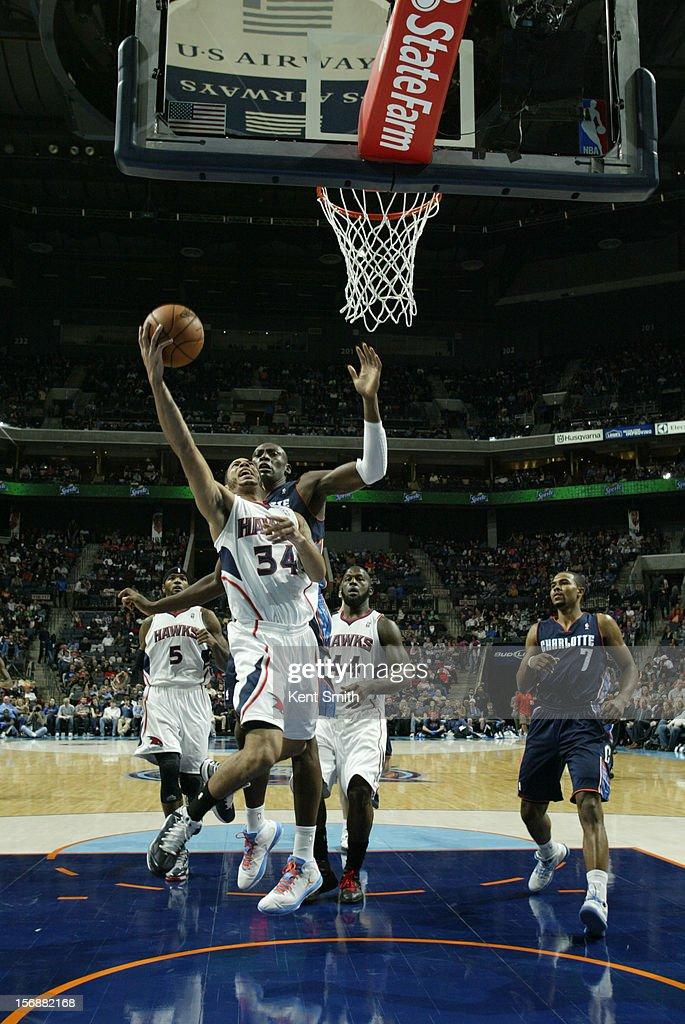 <a gi-track='captionPersonalityLinkClicked' href=/galleries/search?phrase=Devin+Harris&family=editorial&specificpeople=202195 ng-click='$event.stopPropagation()'>Devin Harris</a> #34 of the Atlanta Hawks shoots against the Charlotte Bobcats at the Time Warner Cable Arena on November 23, 2012 in Charlotte, North Carolina.