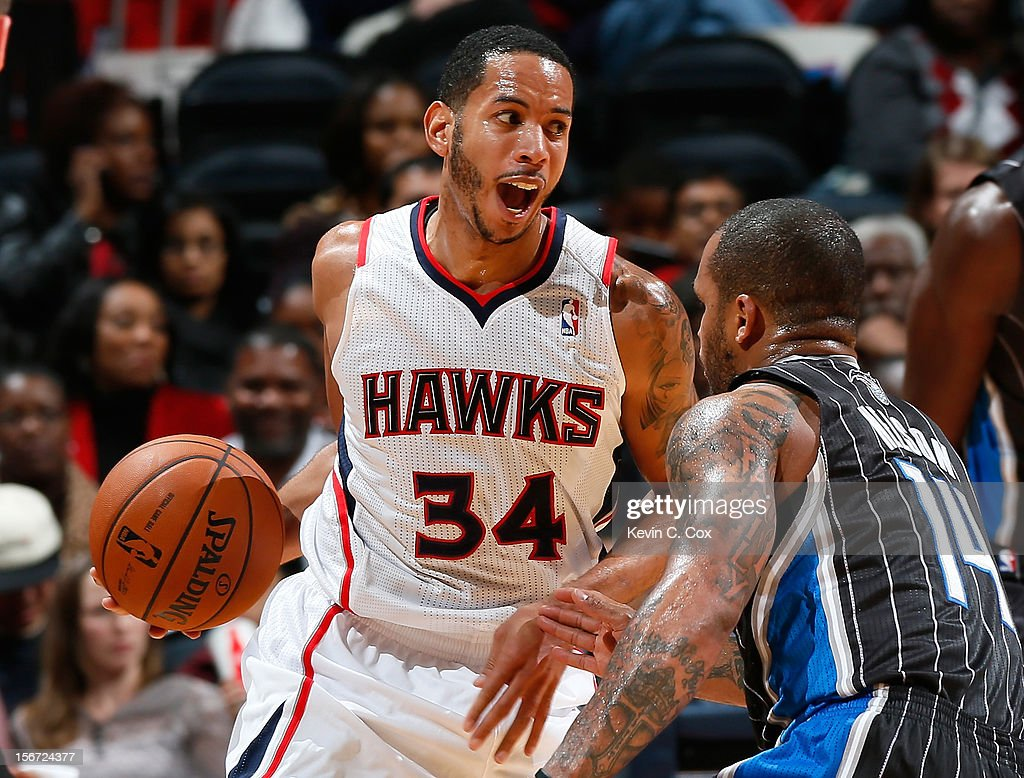 <a gi-track='captionPersonalityLinkClicked' href=/galleries/search?phrase=Devin+Harris&family=editorial&specificpeople=202195 ng-click='$event.stopPropagation()'>Devin Harris</a> #34 of the Atlanta Hawks steals the ball from <a gi-track='captionPersonalityLinkClicked' href=/galleries/search?phrase=Jameer+Nelson&family=editorial&specificpeople=202057 ng-click='$event.stopPropagation()'>Jameer Nelson</a> #14 of the Orlando Magic at Philips Arena on November 19, 2012 in Atlanta, Georgia.