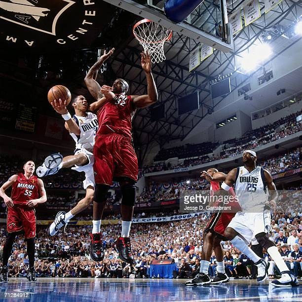 Devin Harris of the Dallas Mavericks attempts a layup against Shaquille O'Neal of the Miami Heat during Game Six of the 2006 NBA Finals played June...