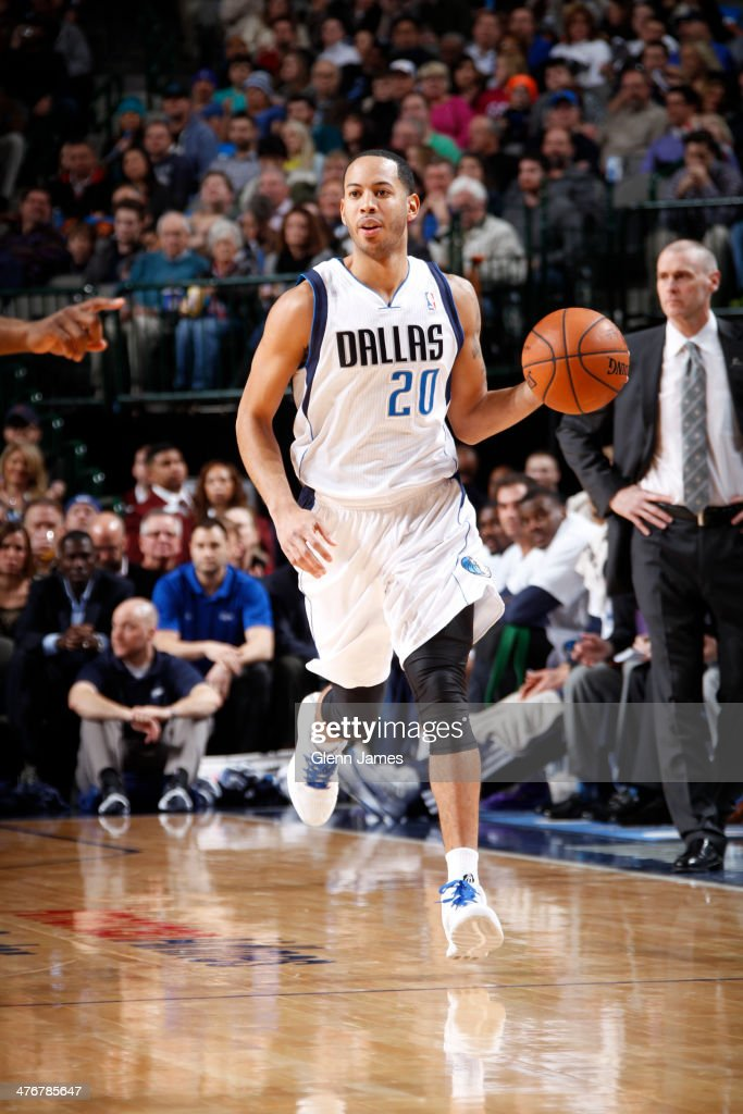 <a gi-track='captionPersonalityLinkClicked' href=/galleries/search?phrase=Devin+Harris&family=editorial&specificpeople=202195 ng-click='$event.stopPropagation()'>Devin Harris</a> #20 of the Dallas Mavericks dribbles the ball against the Utah Jazz on February 7, 2014 at the American Airlines Center in Dallas, Texas.