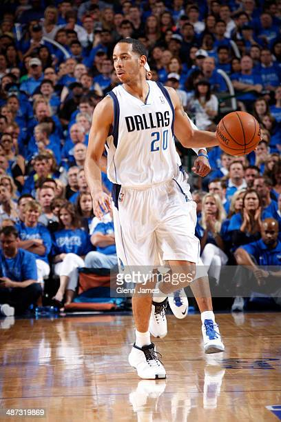 Devin Harris of the Dallas Mavericks dribbles the ball against the San Antonio Spurs during Game Three of the Western Conference Quarterfinals during...
