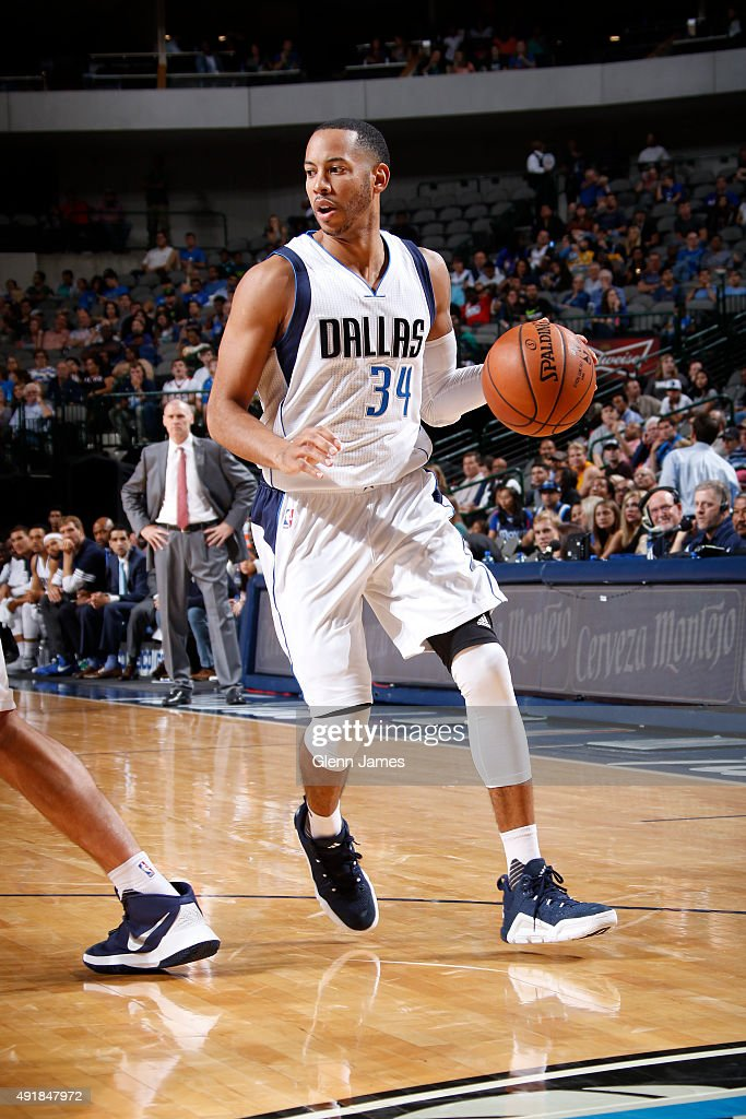Devin Harris of the Dallas Mavericks dribbles the ball against the Denver Nuggets during a preseason game on October 6 2015 at the American Airlines...