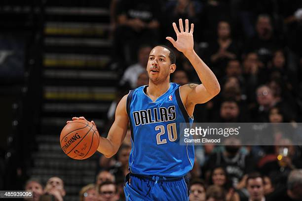 Devin Harris of the Dallas Mavericks dribbles the ball during Game One of the Western Conference Quarterfinals during the 2014 NBA Playoffs against...