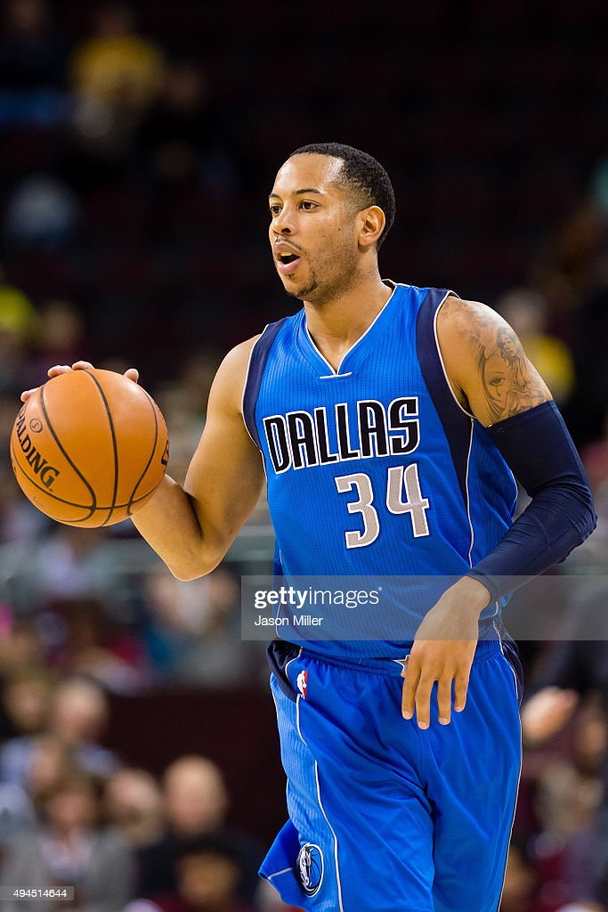 Devin Harris of the Dallas Mavericks drives down court during the first half of a preseason game against the Cleveland Cavaliers at Quicken Loans...