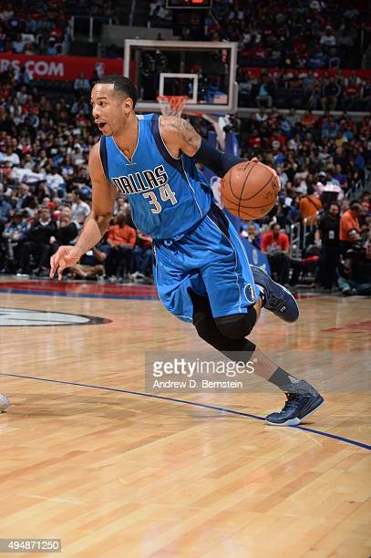 Devin Harris of the Dallas Mavericks drives to the basket against the Los Angeles Clippers during the game on October 29 2015 at STAPLES Center in...