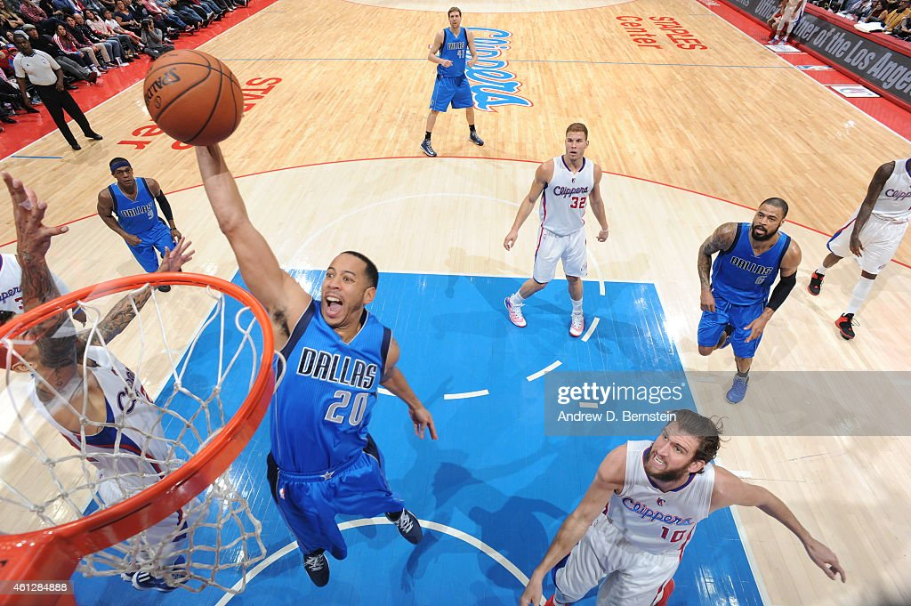 Devin Harris of the Dallas Mavericks goes up for a dunk against the Los Angeles Clippers during the game on January 10 2015 at STAPLES Center in Los...