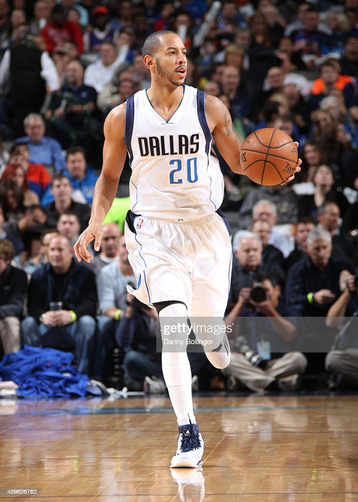 Devin Harris of the Dallas Mavericks handles the ball against the New York Knicks on November 26 2014 at the American Airlines Center in Dallas Texas...