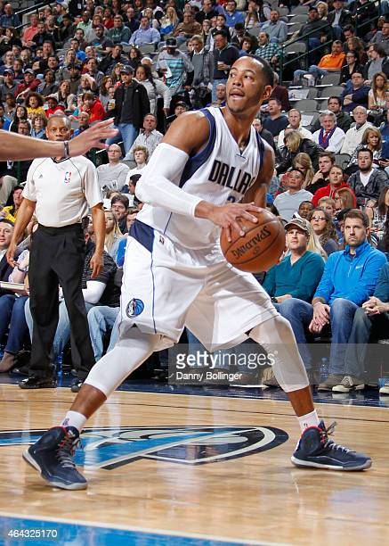 Devin Harris of the Dallas Mavericks handles the ball against the Charlotte Hornets on February 22 2015 at the American Airlines Center in Dallas...