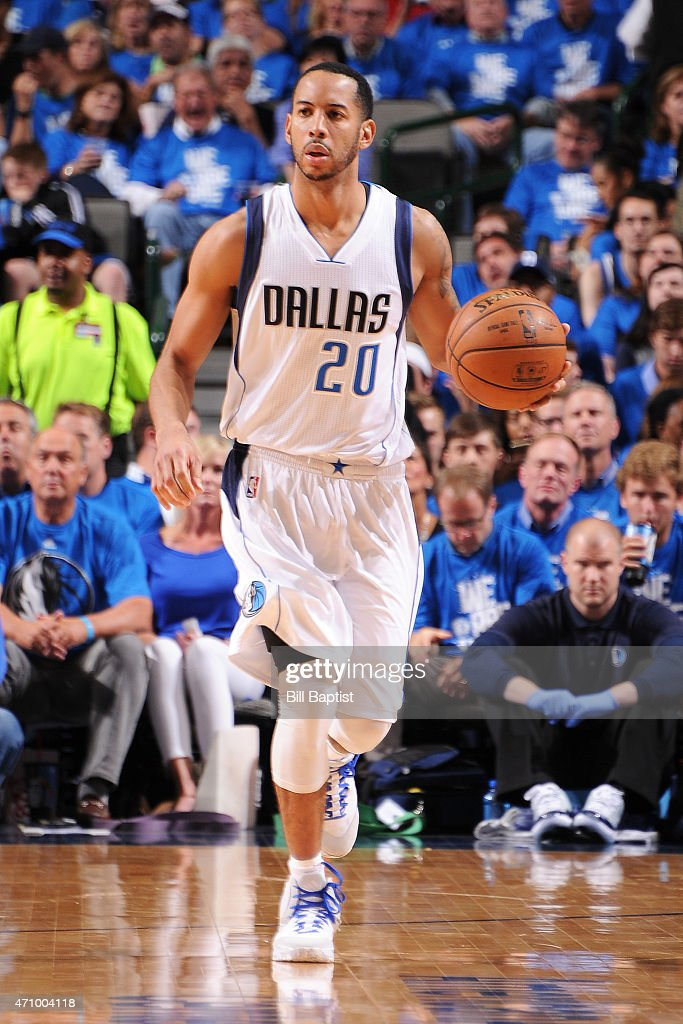 Devin Harris of the Dallas Mavericks handles the ball against the Houston Rockets during Game Three of the Western Conference Quarterfinals on April...