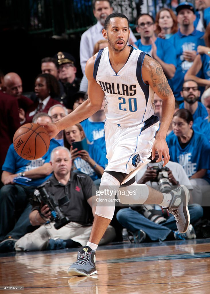 Devin Harris of the Dallas Mavericks handles the ball against the Houston Rockets during Game Four of the Western Conference Quarterfinals of the...