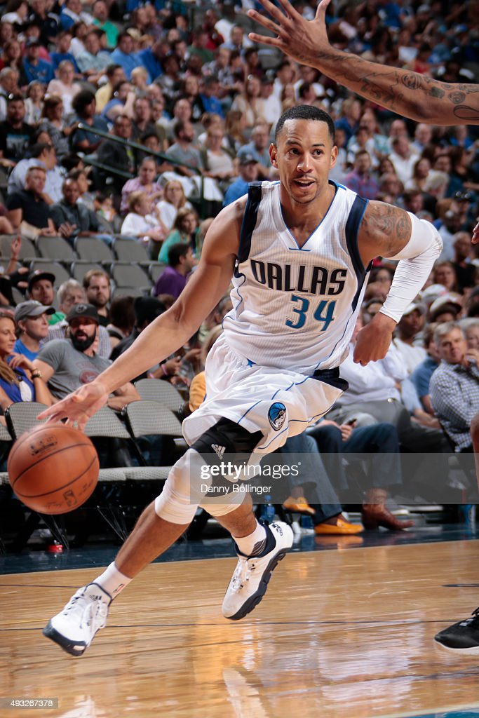 Devin Harris of the Dallas Mavericks handles the ball against the Atlanta Hawks on October 16 2015 at the American Airlines Center in Dallas Texas...