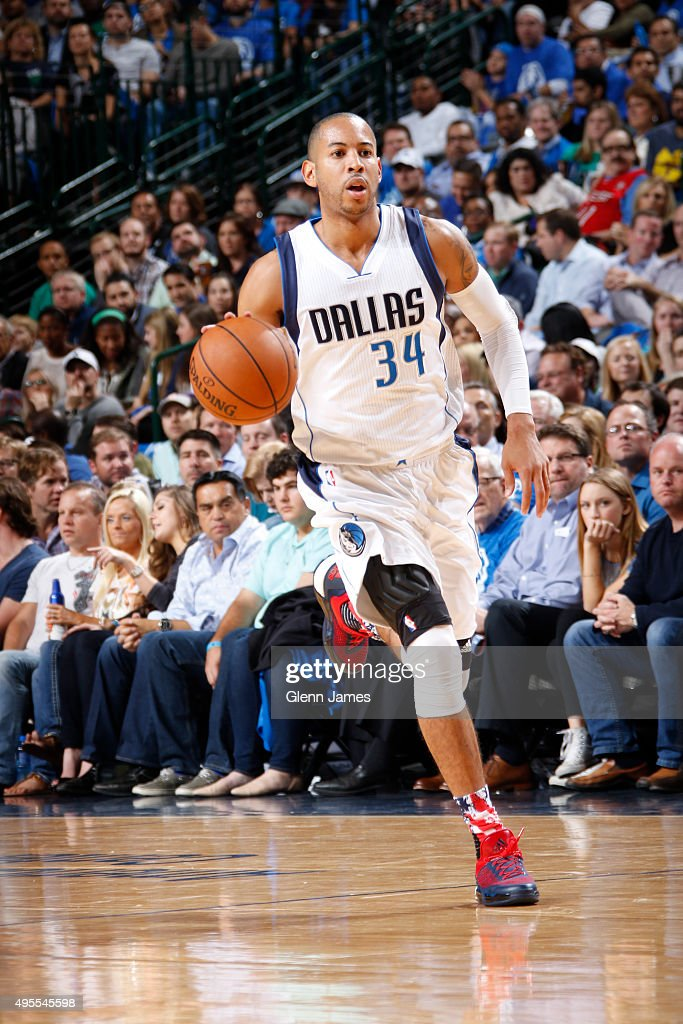 Devin Harris of the Dallas Mavericks handles the ball against the Toronto Raptors on November 3 2015 at the American Airlines Center in Dallas Texas...