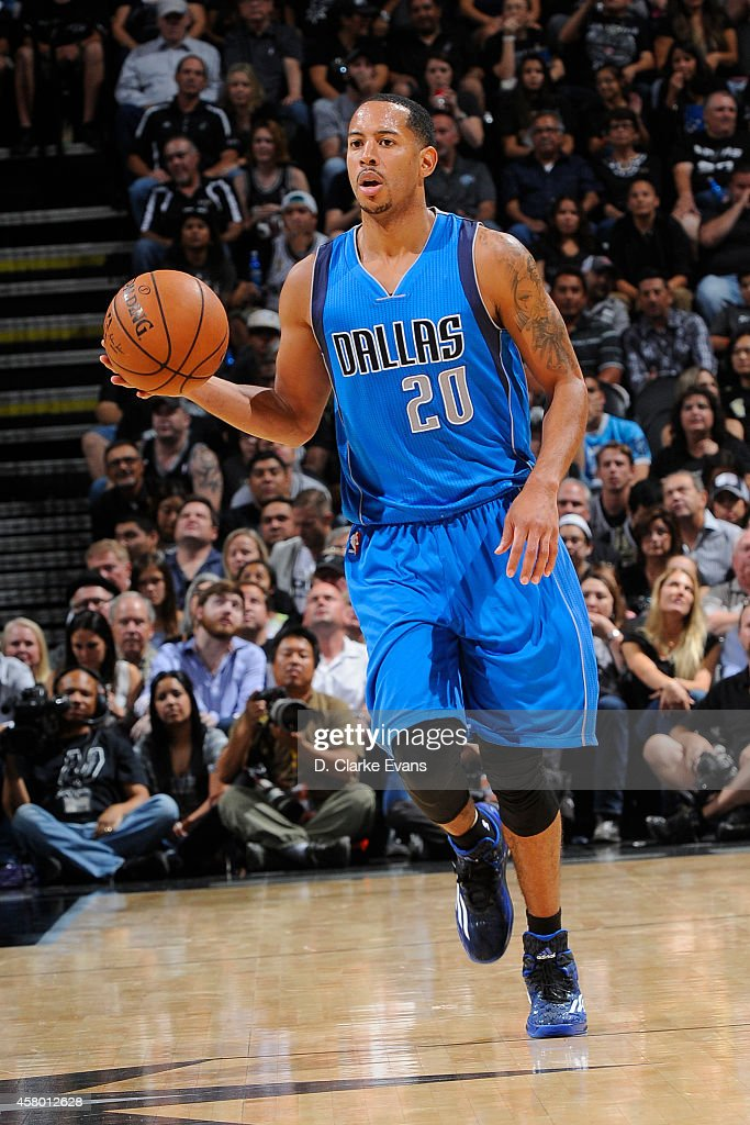 Devin Harris of the Dallas Mavericks handles the ball against the San Antonio Spurs at the ATT Center on October 28 2014 in San Antonio Texas NOTE TO...