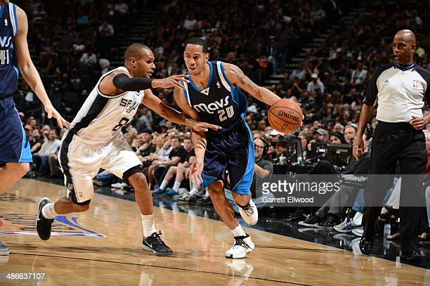 Devin Harris of the Dallas Mavericks handles the ball against the San Antonio Spurs in Game Two of the Western Conference Quarterfinals during the...