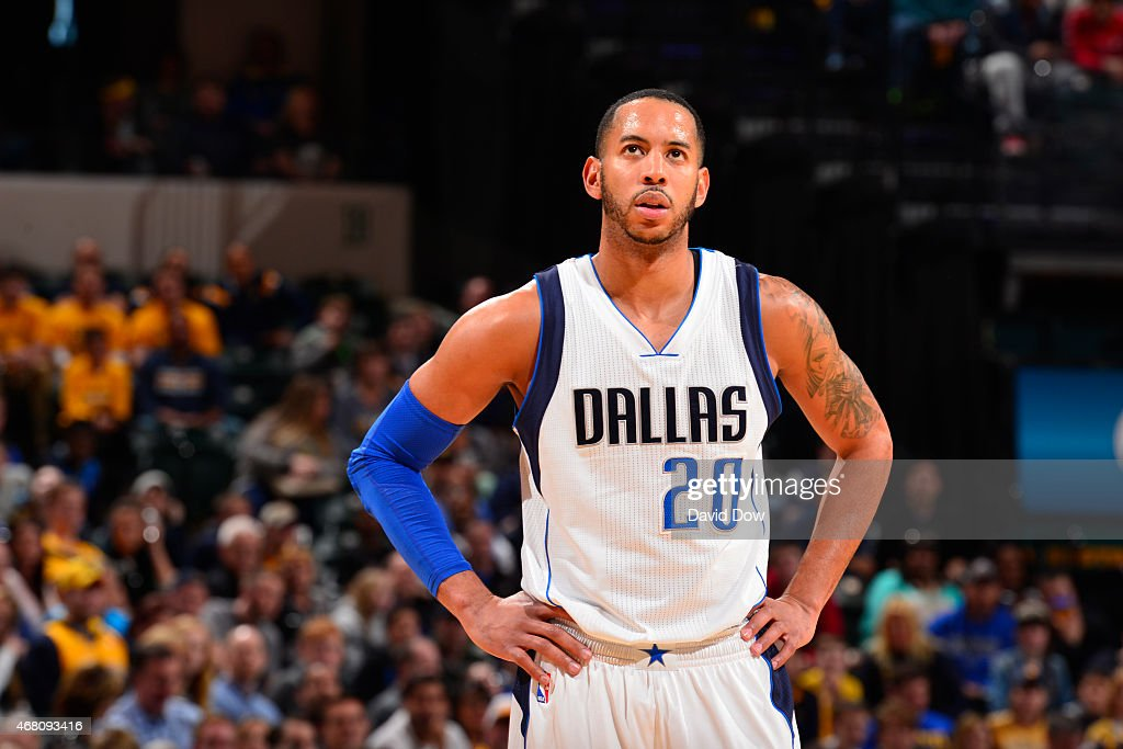 Devin Harris of the Dallas Mavericks looks on against the Indiana Pacers on March 29 2015 at Bankers Life Fieldhouse in Indianapolis Indiana NOTE TO...