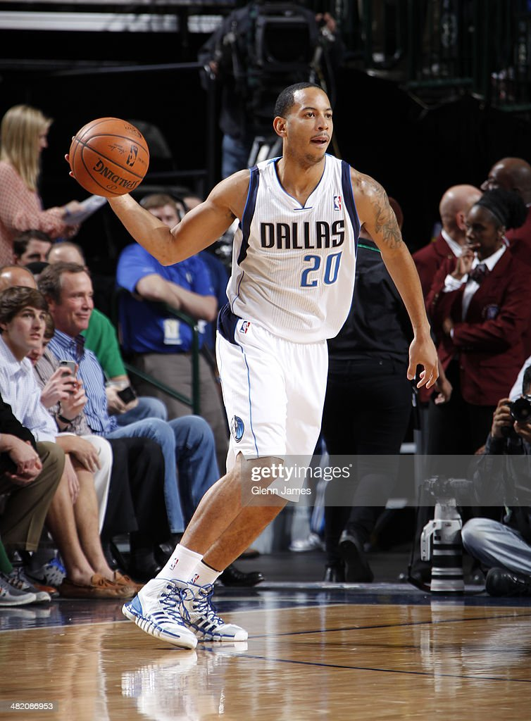 <a gi-track='captionPersonalityLinkClicked' href=/galleries/search?phrase=Devin+Harris&family=editorial&specificpeople=202195 ng-click='$event.stopPropagation()'>Devin Harris</a> #20 of the Dallas Mavericks passes the ball during the game against the Boston Celtics on March 17, 2014 at the American Airlines Center in Dallas, Texas.