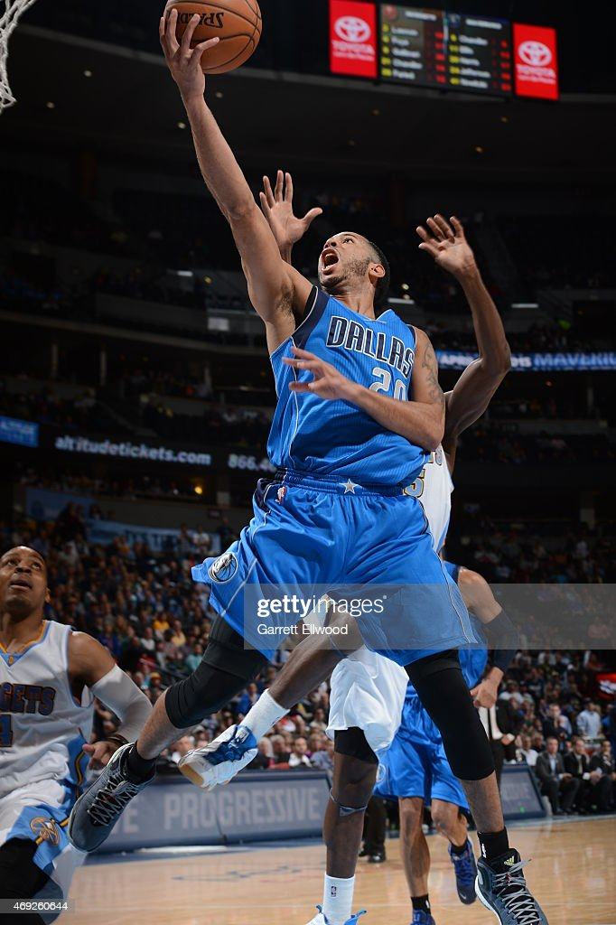 Devin Harris of the Dallas Mavericks shoots the ball against the Denver Nuggets on April 10 2015 at the Pepsi Center in Denver Colorado NOTE TO USER...
