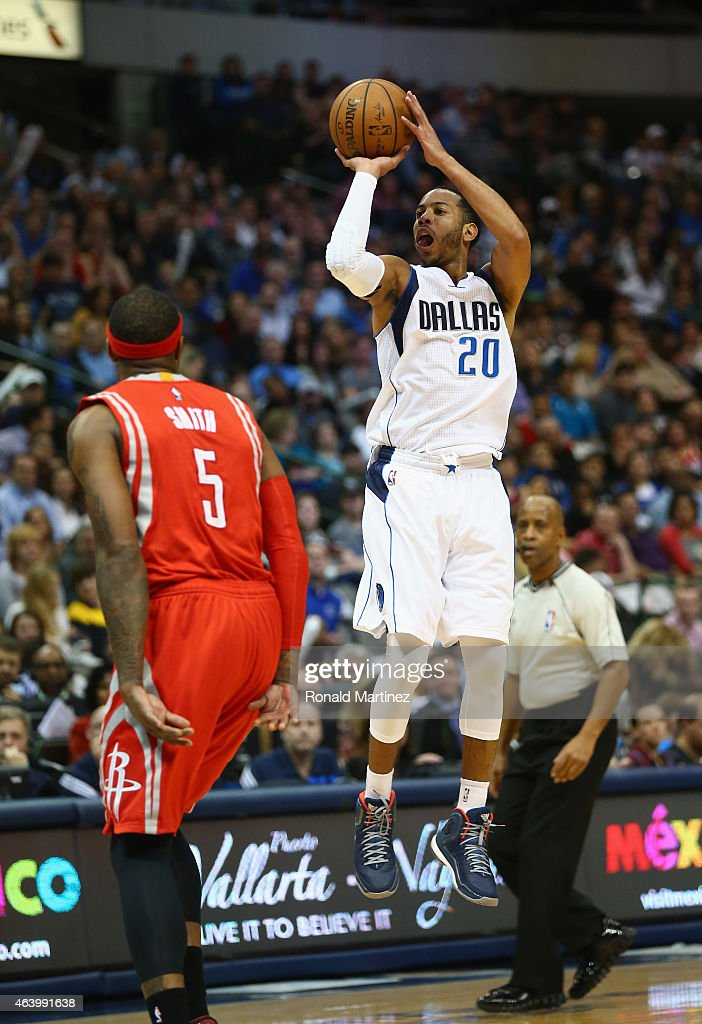 Devin Harris of the Dallas Mavericks takes a shot against Josh Smith of the Houston Rockets at American Airlines Center on February 20 2015 in Dallas...