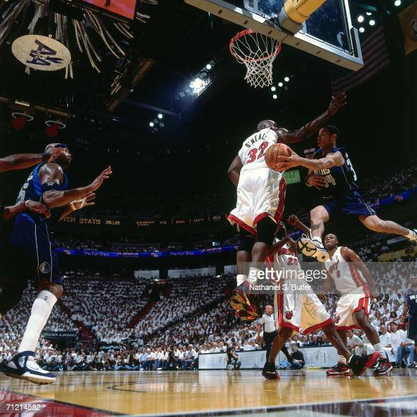 Devin Harris of the Dallas Mavericks throws a pass against Shaquille O'Neal of the Miami Heat during game three of the 2006 NBA Finals played June 13...